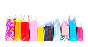 Row of shopping bags. Row of colorful shopping bags isolated on white background royalty free stock photos