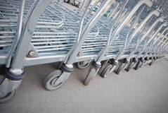 Row of shopping carts Stock Images