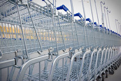 Row of shopping carts. Big group of shopping carts in a row Stock Photos
