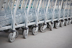 Row of shopping carts. Big group of shopping carts in a row Royalty Free Stock Images