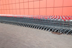 Row of shopping carts at supermarket entrance Royalty Free Stock Photography