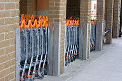 A row of shopping trolleys Stock Photo