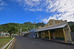Row of shops with old cowboy design building & quiet main road at Levuka, Ovalau island, Fiji Stock Photos