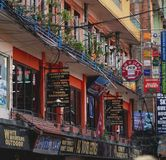 Row of Shops Outdoor Equipment, Bar, Pub and Cafe in Thamel. Editorial Royalty Free Stock Images
