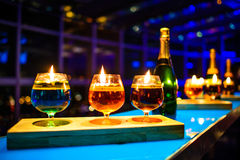 Row of shots on the bar. A Glass standing on table in nightclub Stock Photo