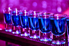 Row of shots on the counter. First is sharp and then they are blurred away Royalty Free Stock Photography