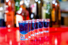 Row of shots on the counter with bar background Royalty Free Stock Photo