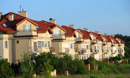 Row of similar houses. Over blue sky royalty free stock photography