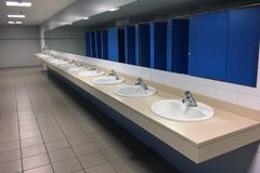 Row sinks in a public toilet. Image of row sinks in a public toilet royalty free stock images