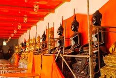 Row of sitting buddha Stock Image