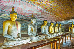 The row of Sitting Buddha statues Stock Photos