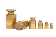 Row of six aged weights royalty free stock image