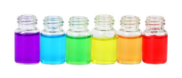 Row of six bottles of  aromatic oils Royalty Free Stock Photo