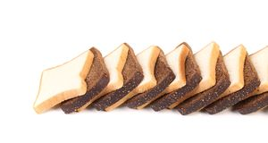 Row of sliced white and black bread. Stock Photo