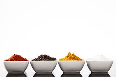 Row of small bowls filled with spices Royalty Free Stock Photo