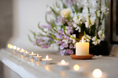 Row of small candles stock photography