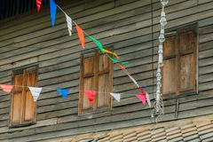 Row of small color flags hanging in the street and decorate the Stock Photos