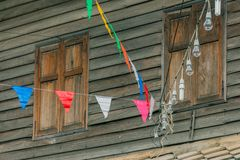 Row of small color flags hanging in the street and decorate the Royalty Free Stock Images
