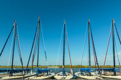 Row of small Dutch sailing boats used for lessons Stock Image