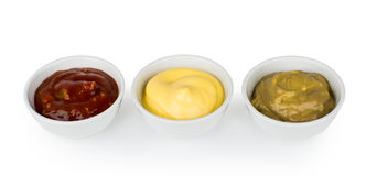 Row of small glass bowls with ketchup, mayonnaise and mustard Stock Photography