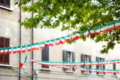 Row of small Italian flags hanging in the street in Desenzano del Garda town Stock Photo