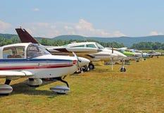 Row of small single engine planes Berkshires MA Stock Photo