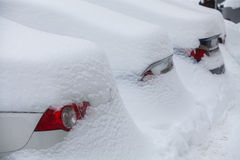 Row of snow-covered cars Royalty Free Stock Images