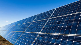 Row of solar panels and blue sky Stock Images