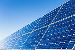 Row of solar panels and clear sky Royalty Free Stock Photography