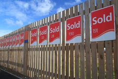 Row of sold signs. On the wooden fence at construction site royalty free stock images