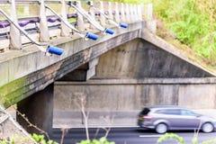 Row of Speed cameras monitoring traffic on UK Motorway.  stock photo