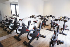 Row Of Spinning Bikes In Gym Stock Image