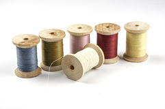 Row of spools with thread Royalty Free Stock Photography