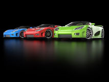 Row of sportscars in black showroom Stock Photo