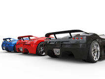 Row of sportscars - side back view Royalty Free Stock Photos