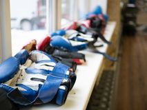Row of sport boxing gloves on a windowsill royalty free stock image
