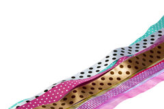 Row of Spotted Multicolored Ribbons on White Royalty Free Stock Photography