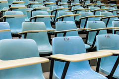 Row stack of chairs in lecture room Stock Images