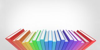 Row stack of colorful books on a plain background Stock Image