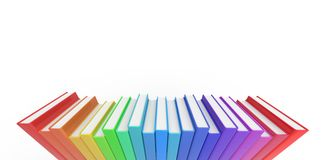 Row stack of colorful books on a plain background Royalty Free Stock Photos