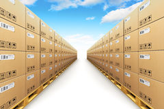 Row of stacked cardboard boxes on shipping pallets Royalty Free Stock Images