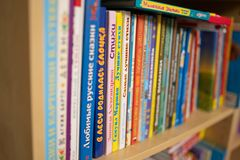 Row of stacked Russian kid books on a shelf. royalty free stock images