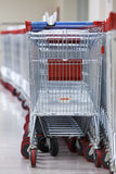 Row of Stacked Supermarket Trolleys. Close-up View of a Row of Stacked Supermarket Trolleys Stock Images