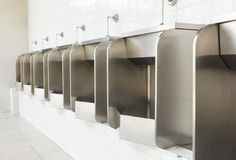 Row of stainless urinals at public restroom Stock Images