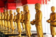 Row of standing buddha statues Royalty Free Stock Photos