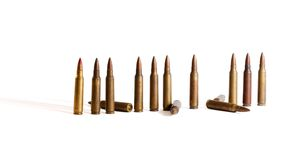 Row of standing  M16 cartridges with some fallen i Royalty Free Stock Images