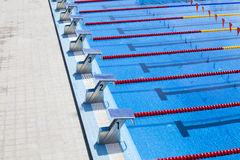 The row of starting blocks of a swimming pool Stock Images