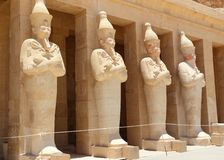 A row of statues of Queen Hatshepsut. A row of statues of Queen Hatshepsut as Osiris, the god of the dead, at her temple in Luxor (Thebes), Egypt Stock Images
