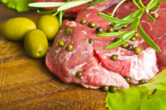 Row Steak whit green pepper Stock Photos