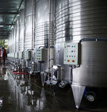 Row of steel cisterns for wine storage. In a modern winery royalty free stock photos